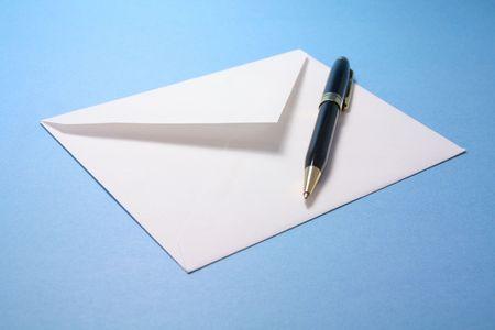 envelope: envelope and pen, concept of communication