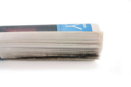 a roll of newspaper, concept of news media