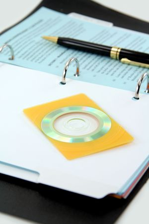 handbook: business card size cd with handbook as background