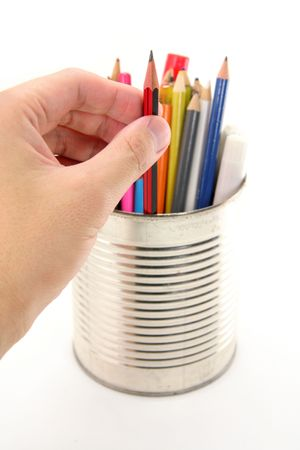 isolated color pencils in tin photo