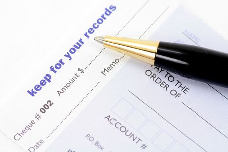 bank records: cheque with pen for business concept