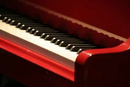 ivories: red piano, keyboard  close up