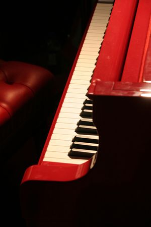 symphonic: red piano with red bench Stock Photo