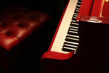 ivories: red piano with red bench Stock Photo