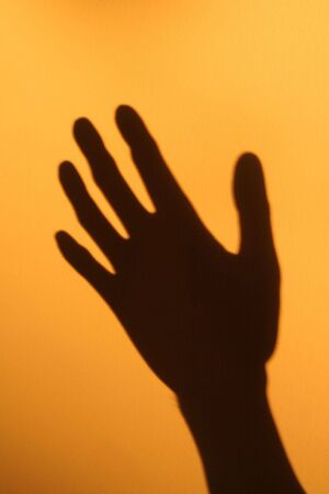 horrible hand shadow with yellow background Stock Photo - 568918
