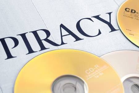illegal: cd and word of piracy, concept of illegal copy Stock Photo