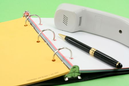 telephone and notebook, concept of office work Stock Photo