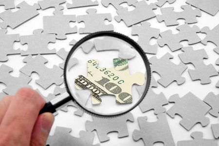 us dollar puzzle and magnifier, business concept photo