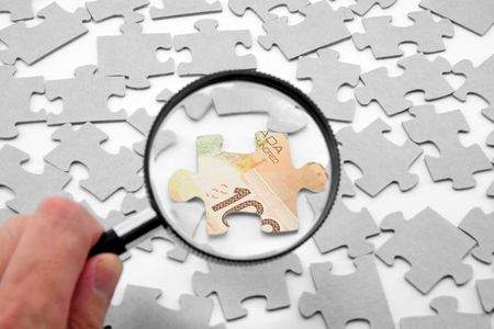canadian dollar puzzle and magnifier, business concept Stock Photo - 627221