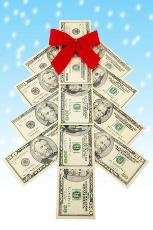 christmas profits: Money Christmas tree and snow Stock Photo