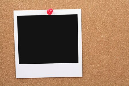 post: blank photo post on corkboard Stock Photo