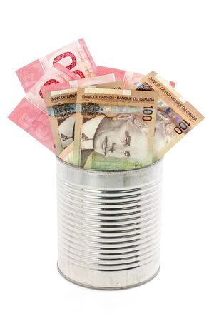 canadian currency: canadian dollars and tin, concept of making money, or money gift