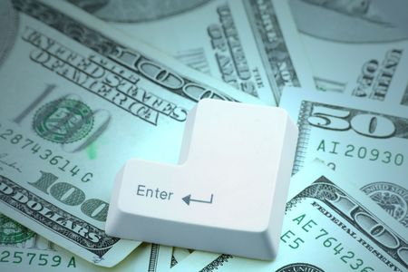 enter key: Dollars and a enter key, concept online shopping Stock Photo