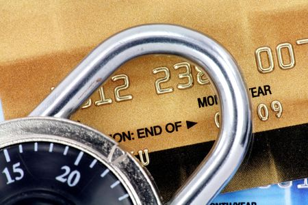 Close up of credit card and lock,  concept of security photo