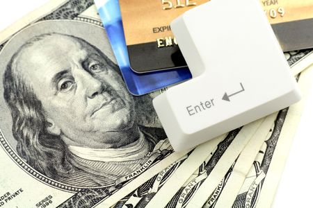 enter key: credit card, Dollars and a enter key, concept online shopping Stock Photo