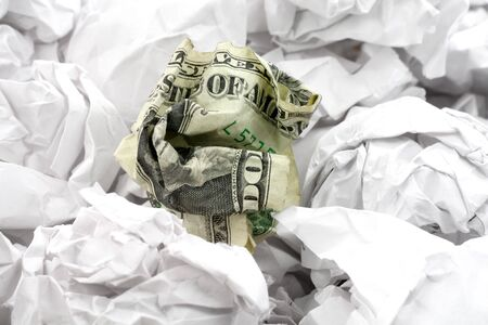 scrunched: crumpled usa dollar ball, business concept
