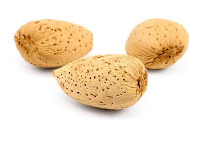 nutshells: yellow almonds with white background Stock Photo