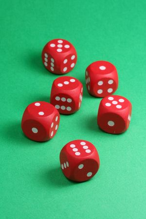 red dices on green background Stock Photo - 718514