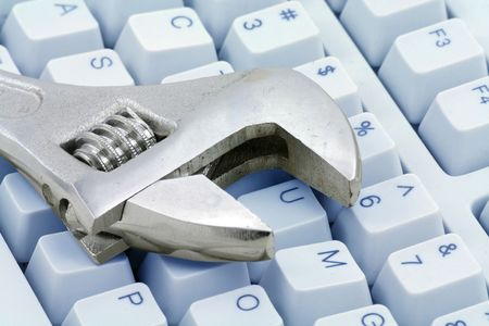 Adjustable Wrench and keyboard, concept of computer repairing Stock Photo - 731411