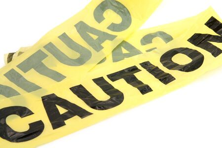 yellow plastic caution tape with white background
