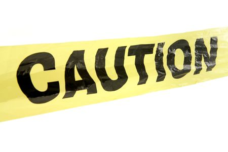 alertness: yellow plastic caution tape with white background