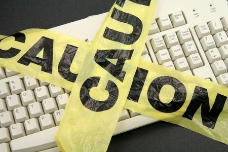 crime: plastic caution tape and keyboard, computer crime