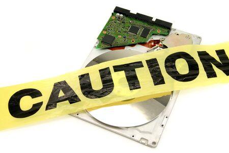 plastic caution tape and harddisk, computer crime Imagens