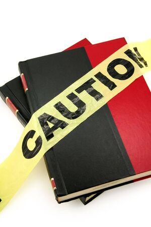 plastic caution tape and book, forbidden book Banco de Imagens