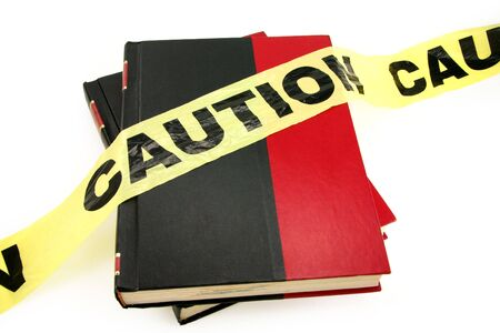 prohibitive: plastic caution tape and book, forbidden book Stock Photo