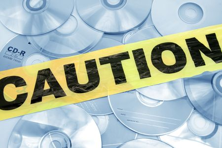 plastic caution tape and CD, computer crime Stock Photo - 763662