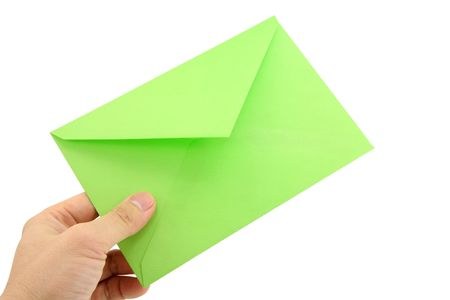 hand holding green envelope, concept of communication Stock Photo