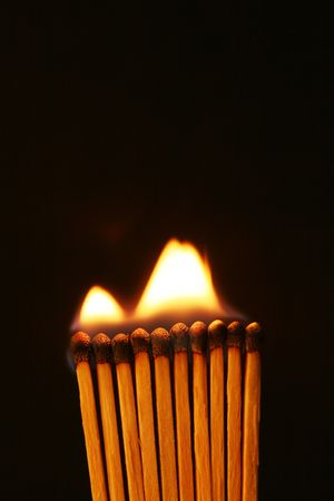 Burning Matches with black background Banco de Imagens