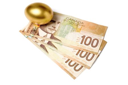priceless: golden egg and canadian dollars, concept of Making Money Stock Photo