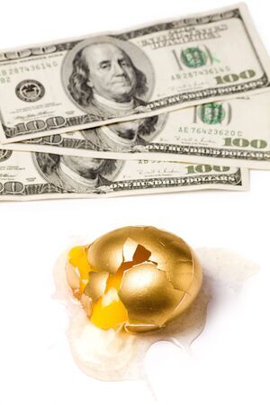 broken golden egg and dollars, concept of financial risk Stock Photo - 950315