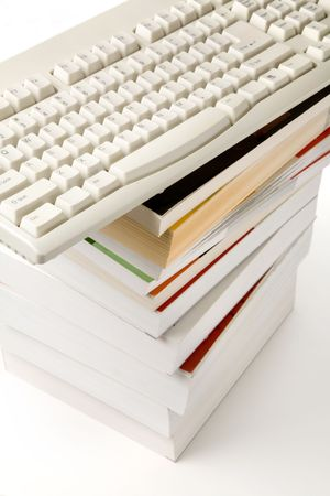 alphabet computer keyboard: book and computer keyboard, concept of online learning Stock Photo
