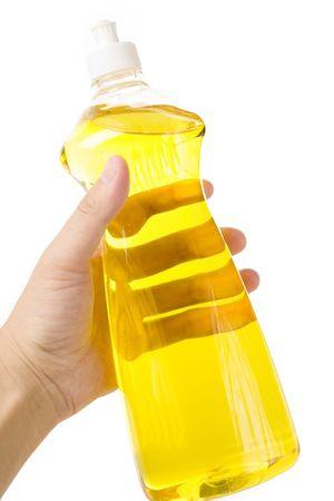 lavar platos: un l�quido amarillo de Dishwashing de la botella Foto de archivo