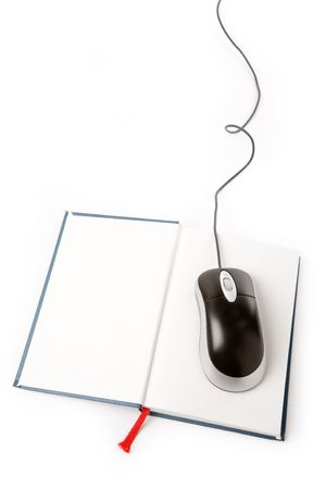 computer mouse and book, concept of online education photo