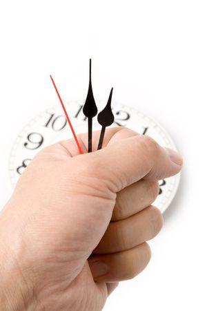 holding clock hands, concept of time control Banco de Imagens
