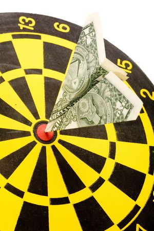 dollar paper airplane on a dartboard, concept of success