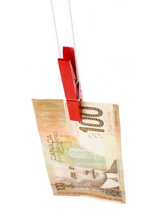 Clothespin and canadian dollar with white background photo