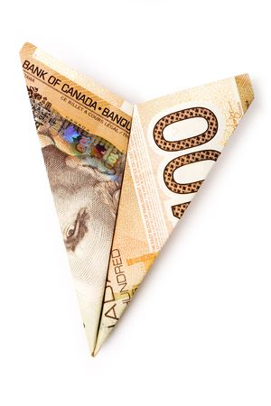 canadian dollar: canadian dollar paper airplane, business concept