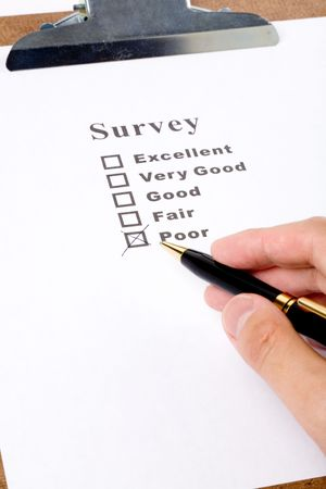 questionnaire and pen, business concept Фото со стока