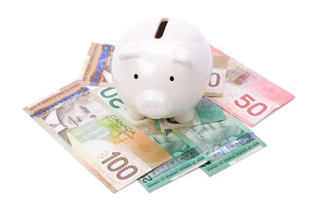 canadian currency: Piggy Bank and canadian dollars close up shot Stock Photo