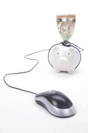 Piggy Bank and computer mouse, concept of e-commerce, online banking photo