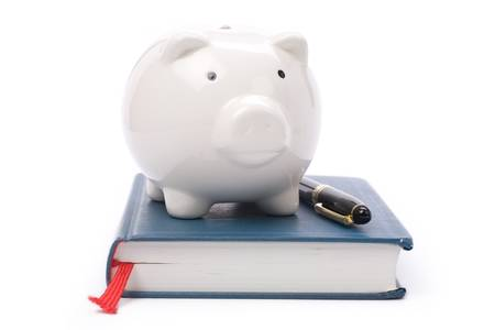 college fund savings: book and Piggy Bank, concept of education fund, tuition