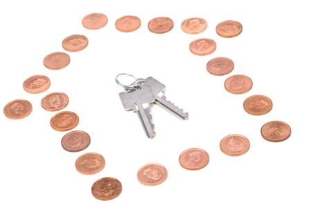 coins and home keys, concept of Real Estate finance photo