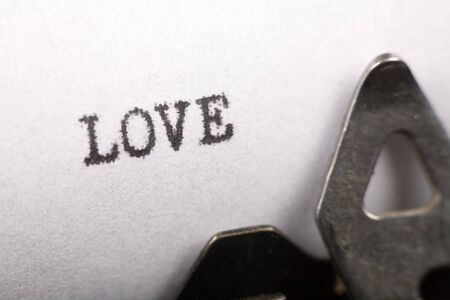 Typewriter close up shot, Concept of love Stock Photo