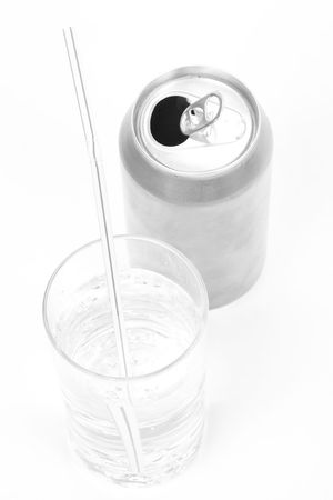 soda can: silver soda can and glass with white background