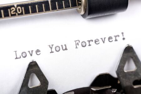 Typewriter close up shot, Concept of Love You Forever Stock Photo
