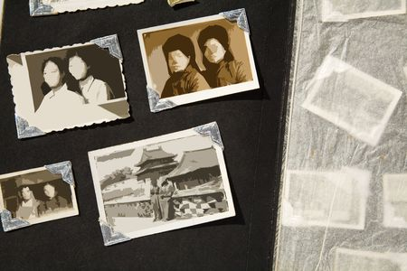 old photo: Photo Album with old stained photos, all photos have been blurred, so you can use the photo frame and put your photo in.